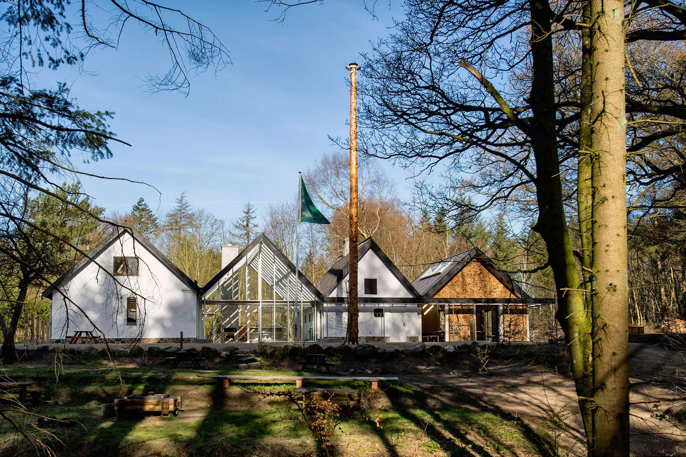 Lumo Arkitektur adds glass and log volumes to Nøjkærhus Culture House