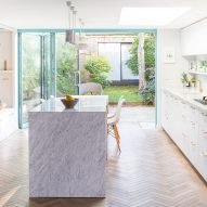 Herringbone parquet, grey marble and brass feature in revamped Stoke Newington house