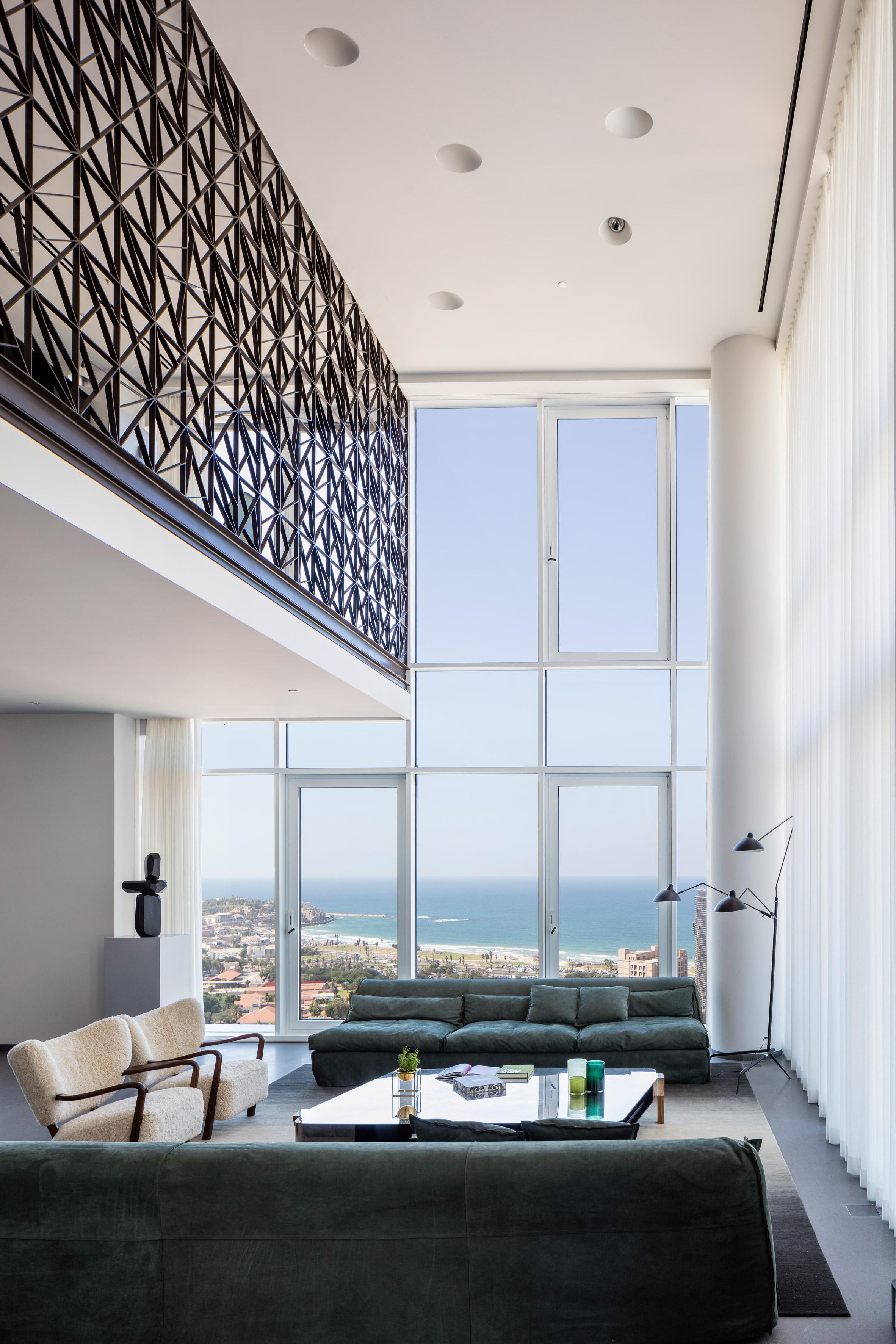 Pitsou Kedem designs dark brass lattice wall for Tel Aviv apartment