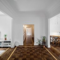 Aboim Inglez Arquitectos overhauls 1930s apartment in Lisbon with wooden parquet and grey marble