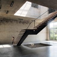 Concrete art gallery and studio in Bangkok features four-storey atrium