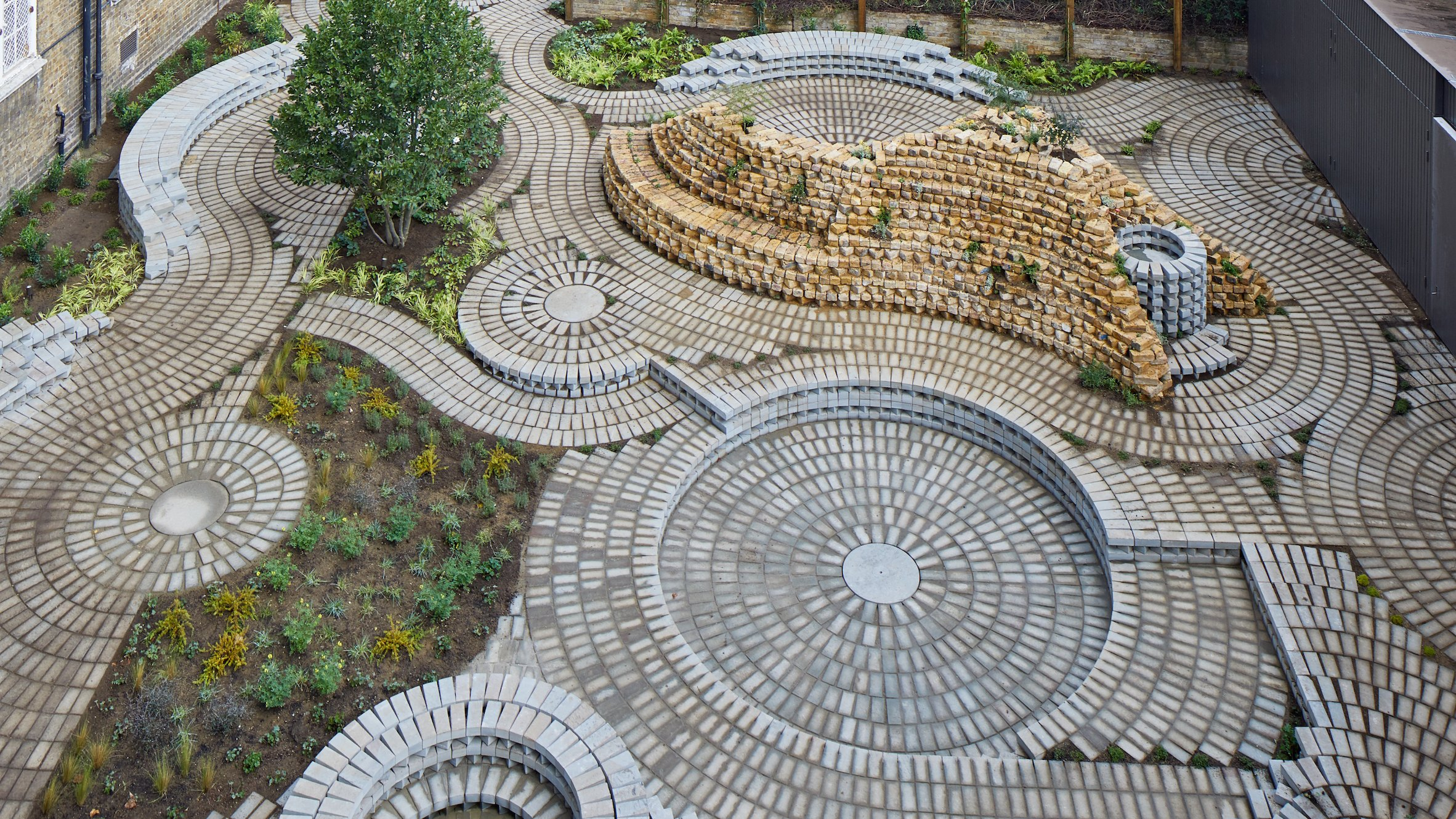 swirling brick circles form back garden for south london gallery