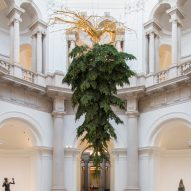 Upside-down Christmas tree suspended from Tate Britain ceiling