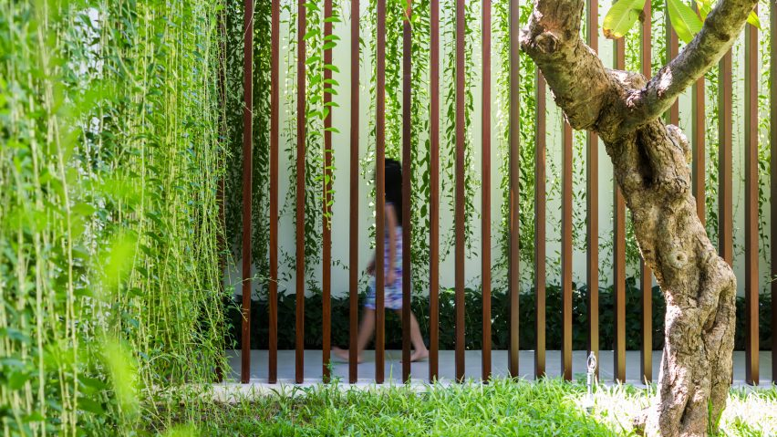 Mia Design Studio Envelopes Vietnam House In Plant-Covered Walls