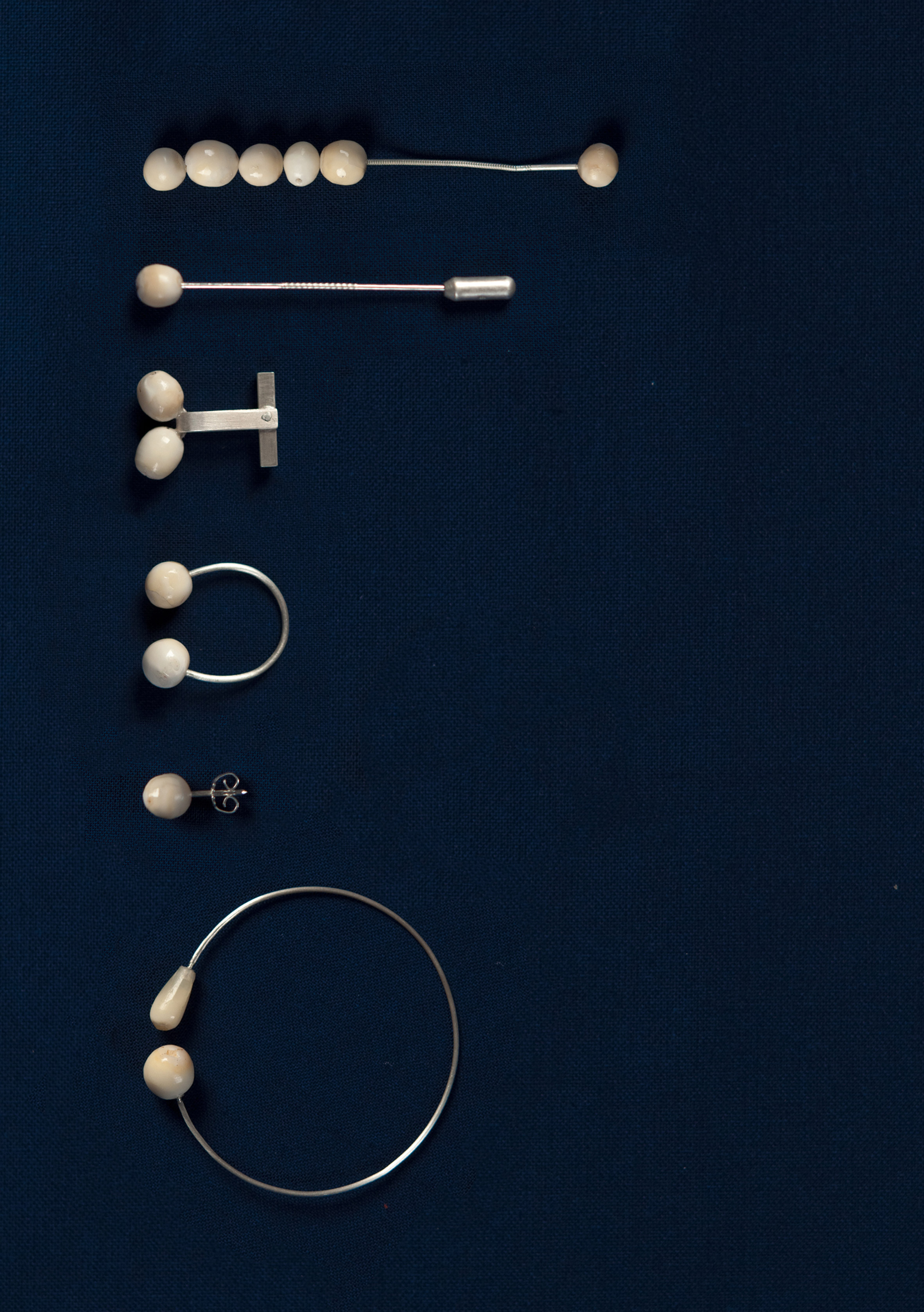 "Lucie Majerus makes ""pearl"" jewellery from her own teeth"