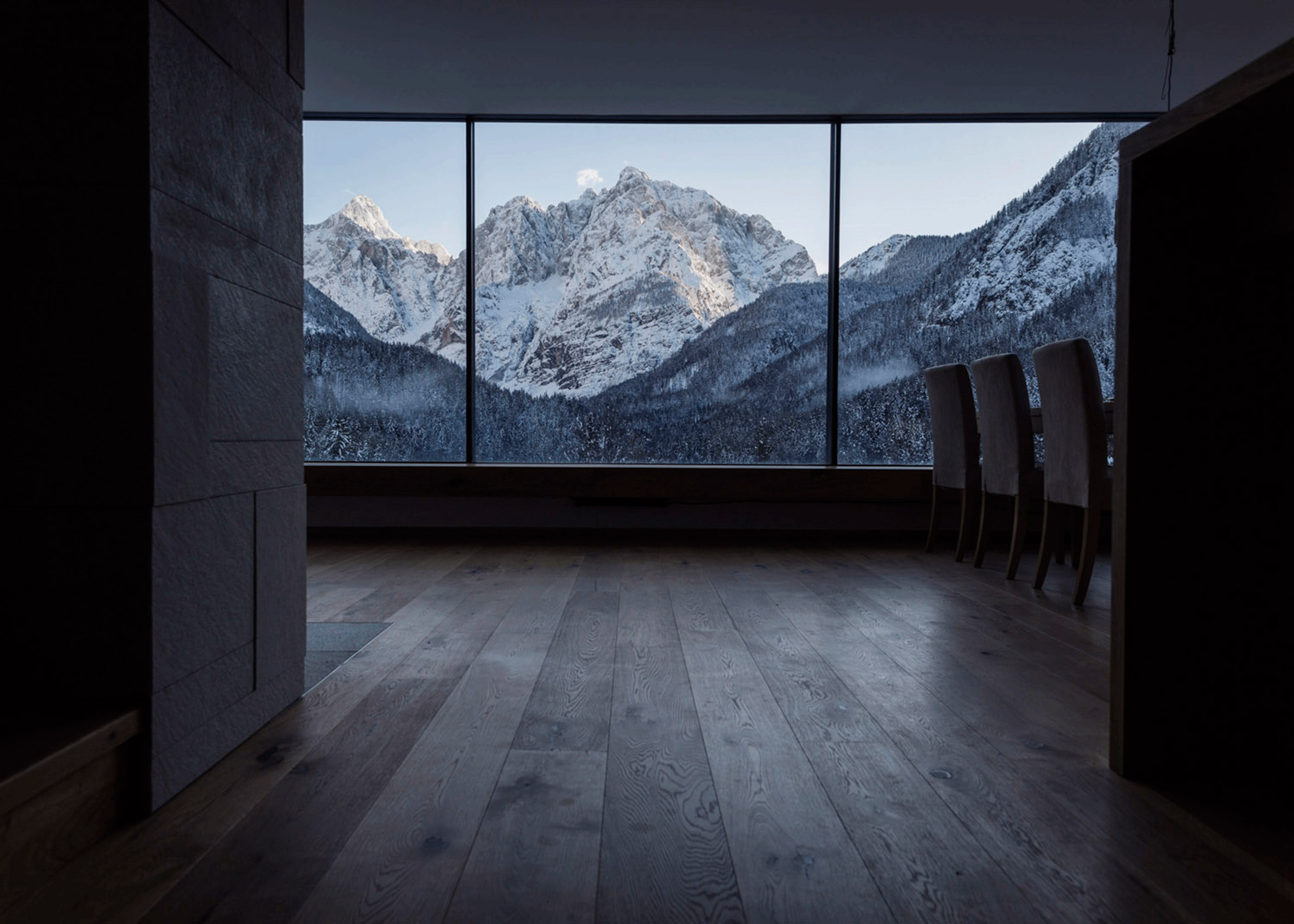Slovenian holiday home by Prima features glass, larch and aluminium walls