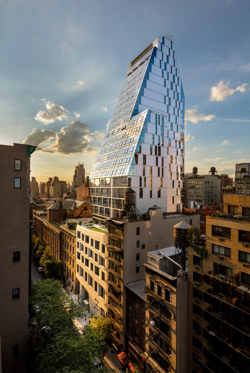 Giant slanted glass wall defines New York apartment tower by FXFOWLE