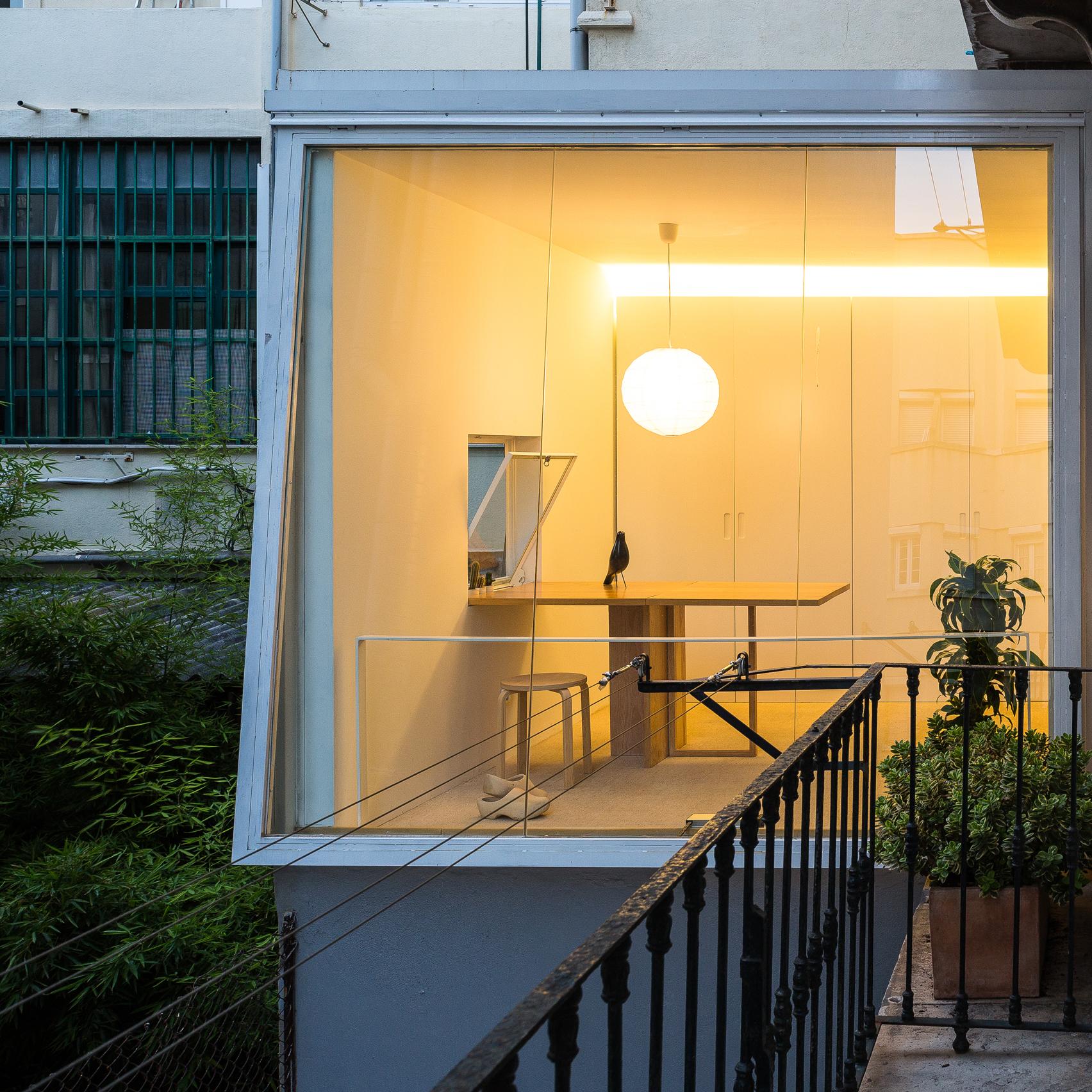huge window frames garden views from boxy lisbon apartment
