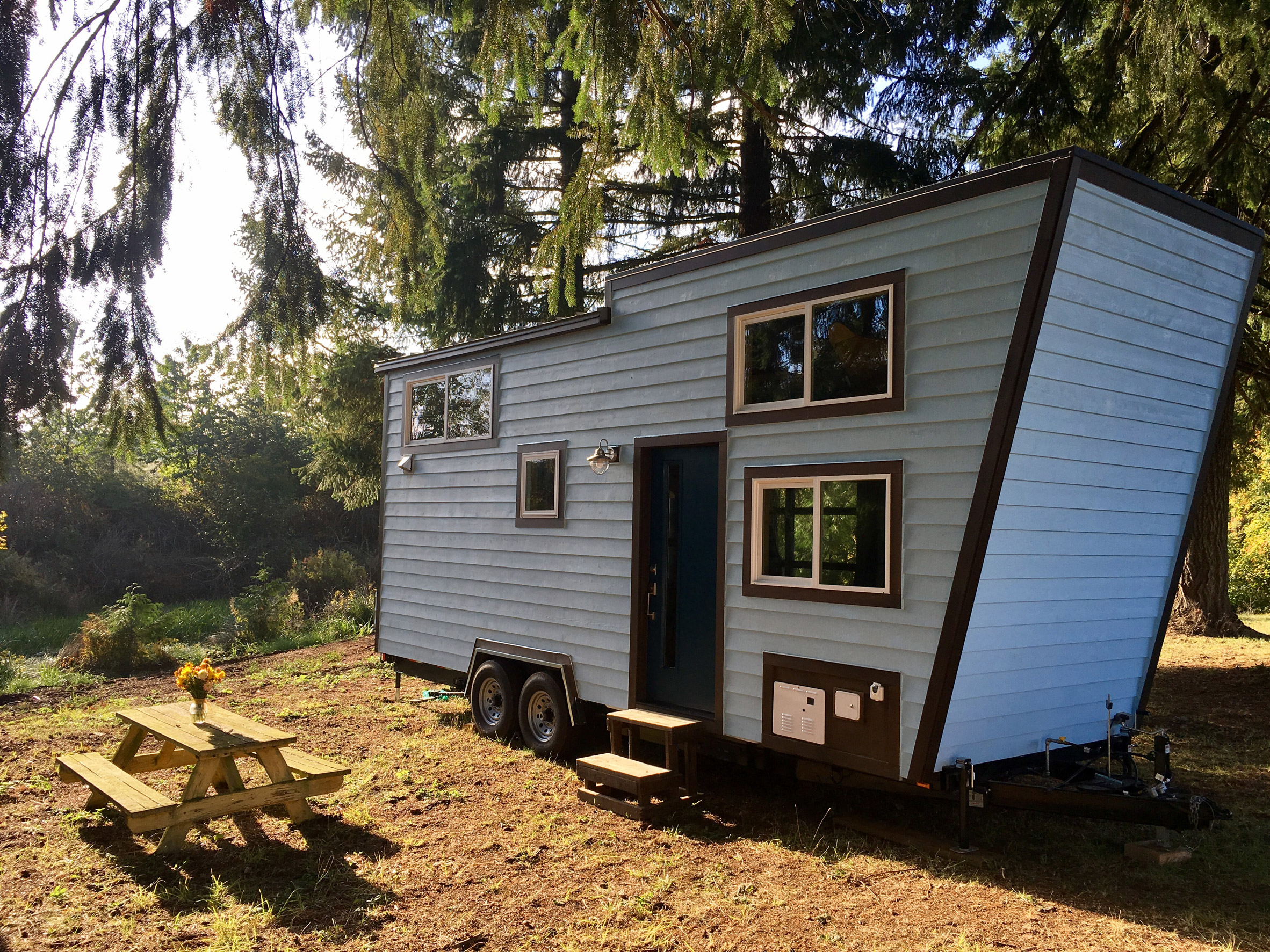 Tiny Heirloom micro cabin boasts spilt-level living space and a climbing wall