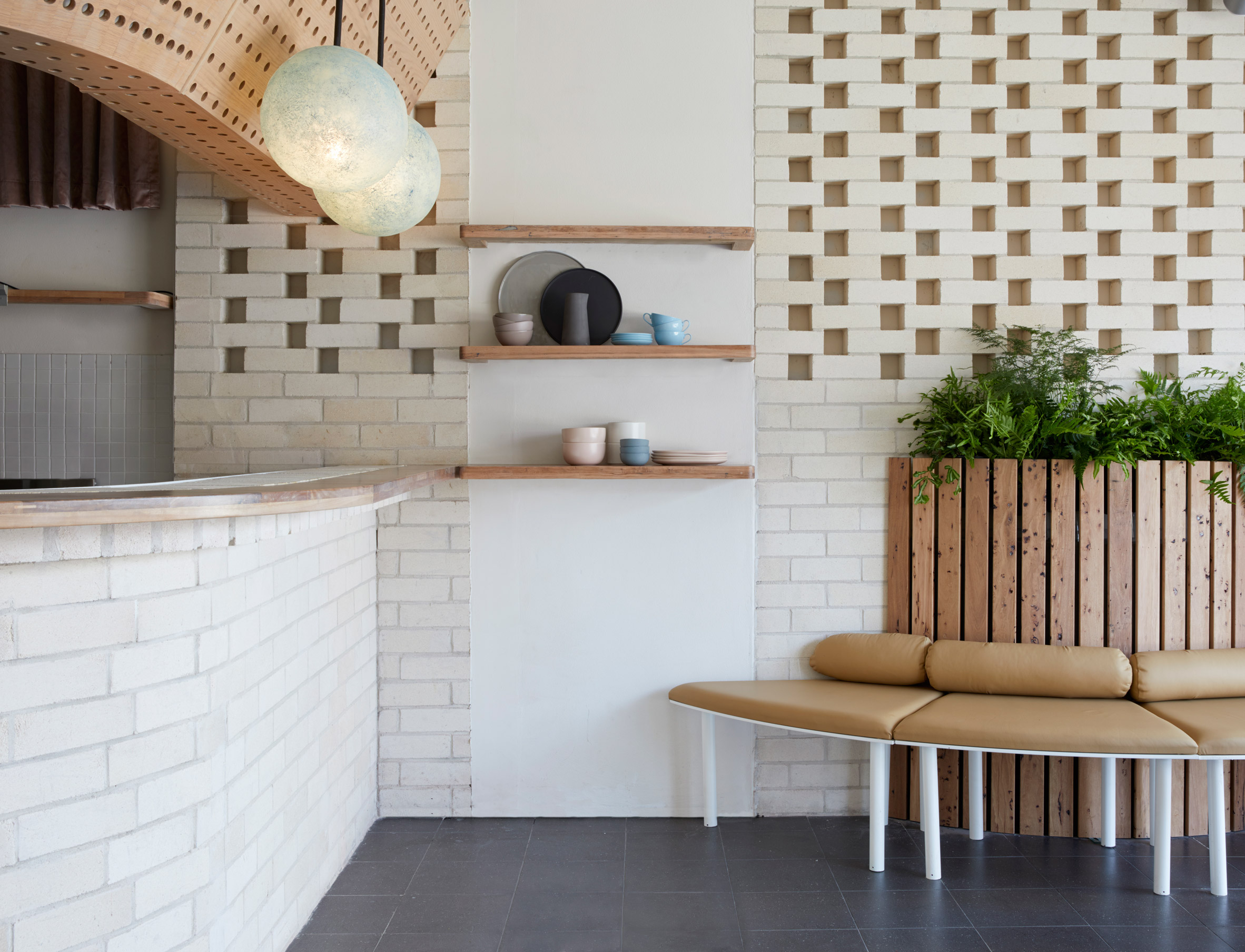 White brick and reclaimed eucalyptus wood fill Sydney Dessert Kitchen