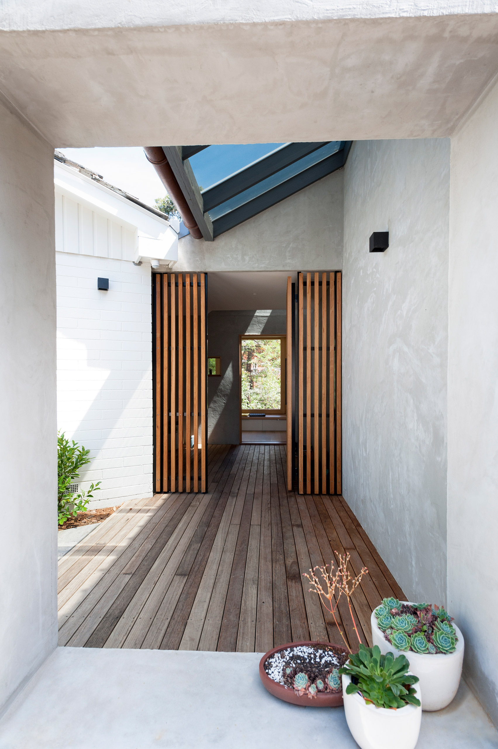 Gabled extension improves connection between Melbourne house and its mature garden