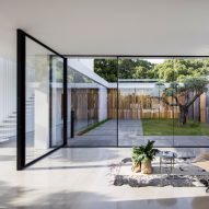 Walls of glass, stone and wood line courtyards at Pitsou Kedem's House F