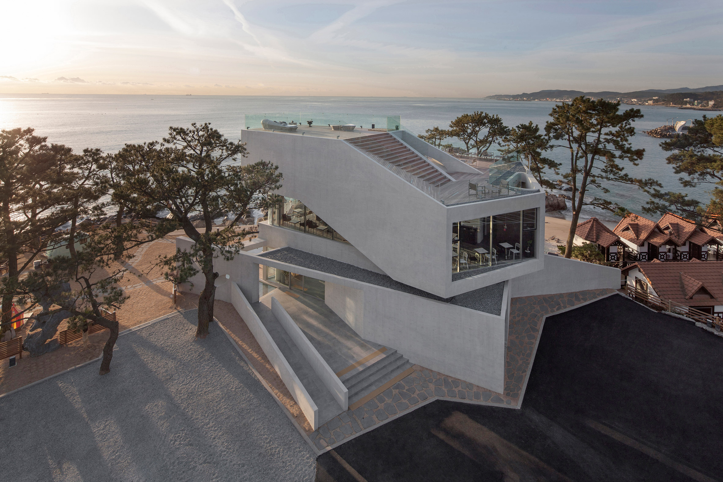 Stacked concrete blocks and roof deck give diners sea views from South Korean cafe by IDMM Architects