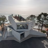 Stacked concrete blocks and roof deck give diners sea views from South Korean cafe