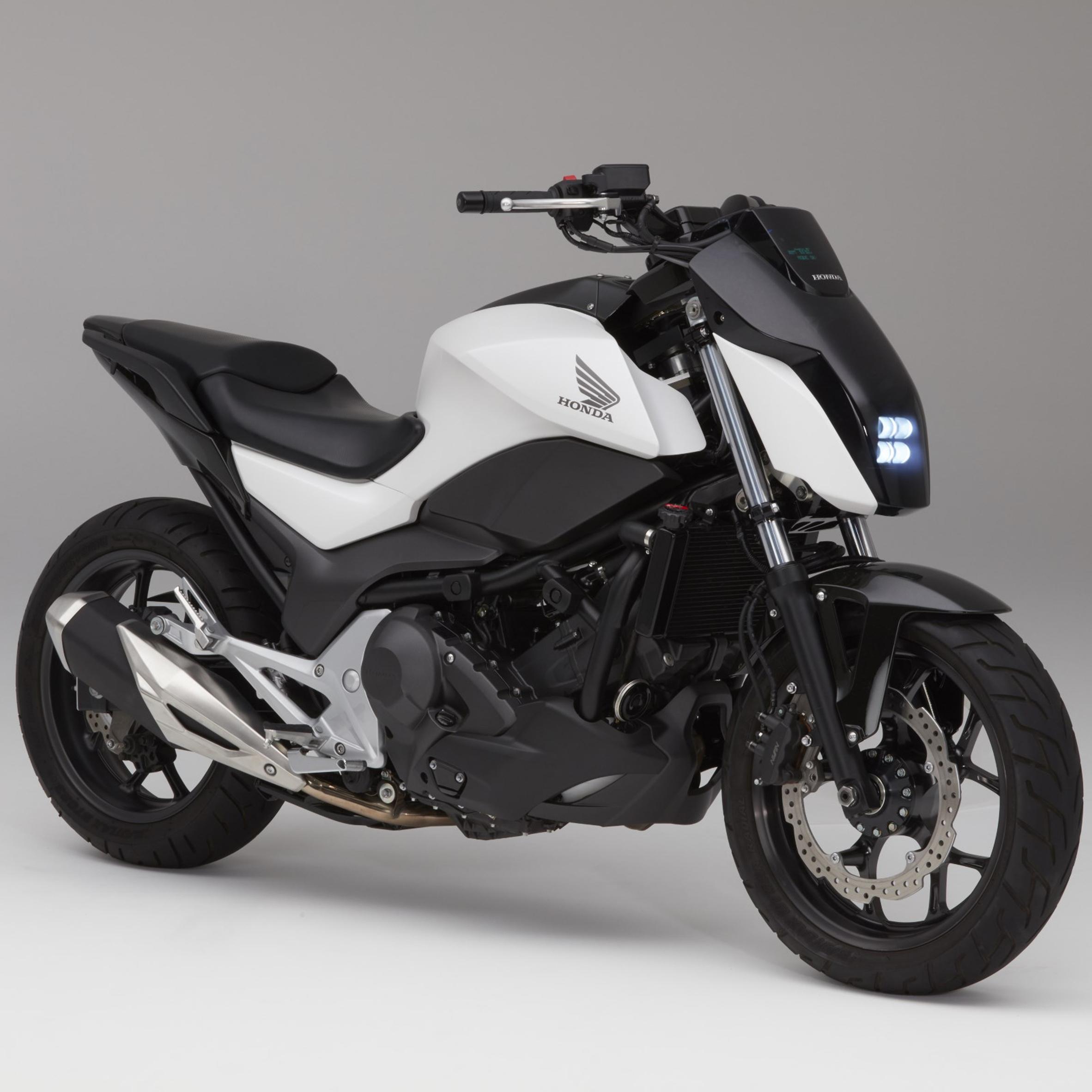 Honda unveils self-balancing motorcycle that can drive itself Dezeen