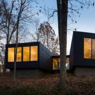 Architecturefirm perches black country home on forested hilltop in Virginia