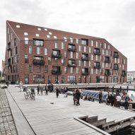 COBE and Vilhelm Lauritzen Architects complete warehouse-inspired housing for Copenhagen harbour