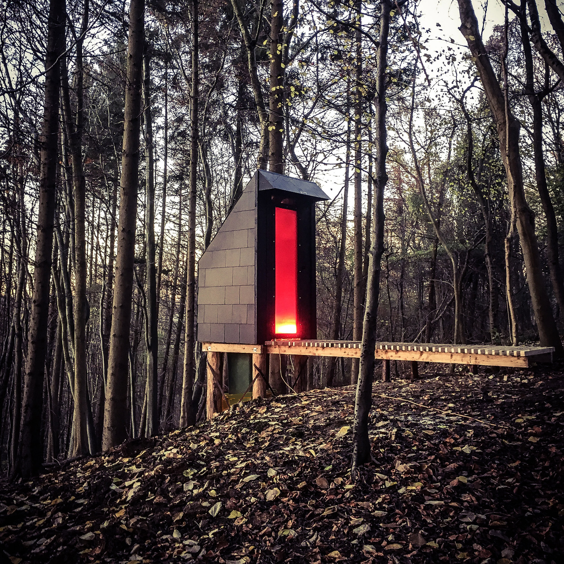 Invisible Studio designs composting toilet for woodland workshop