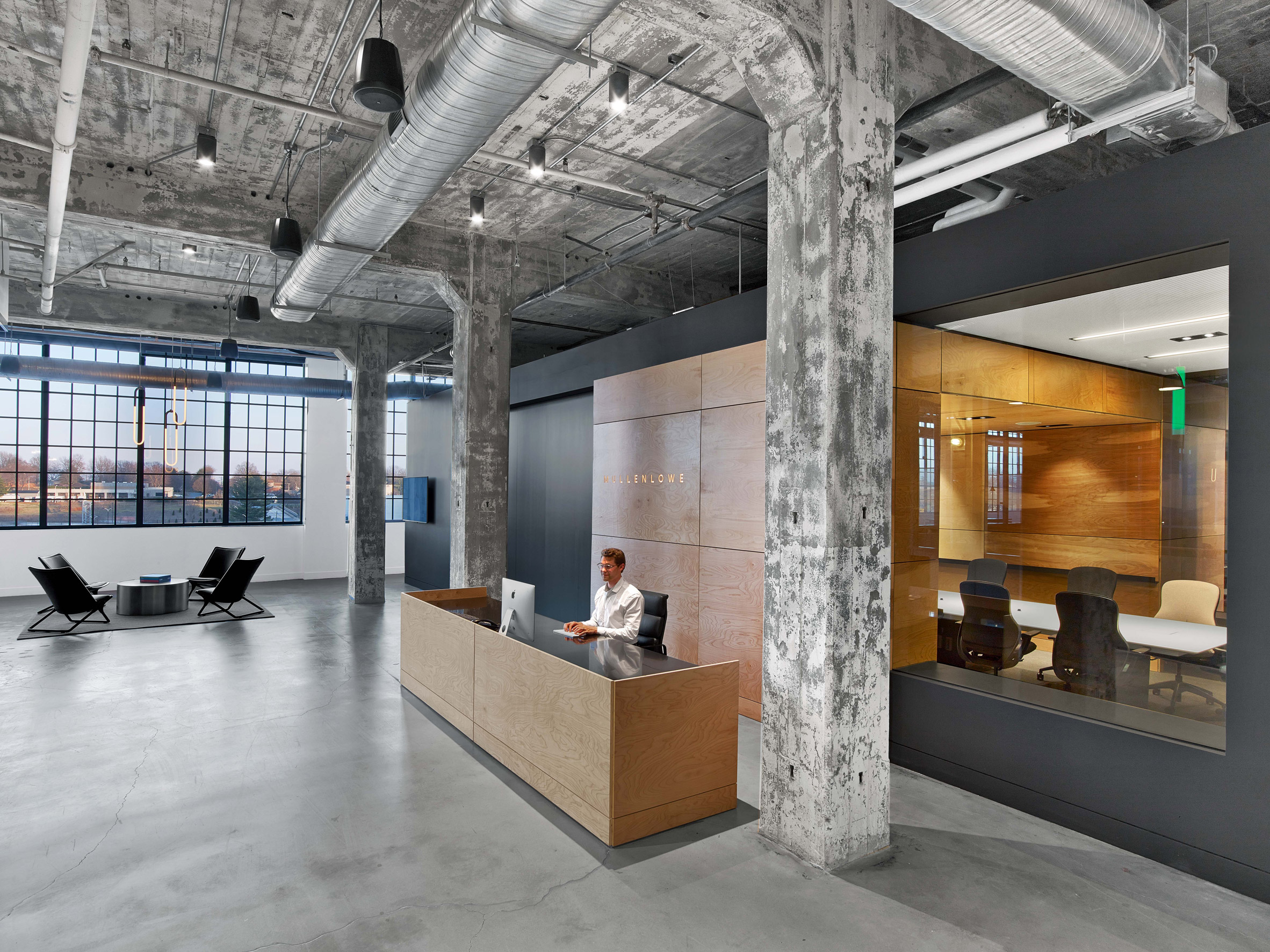 Tpg architecture adapts tobacco factory into ad agency for Ad agency office design
