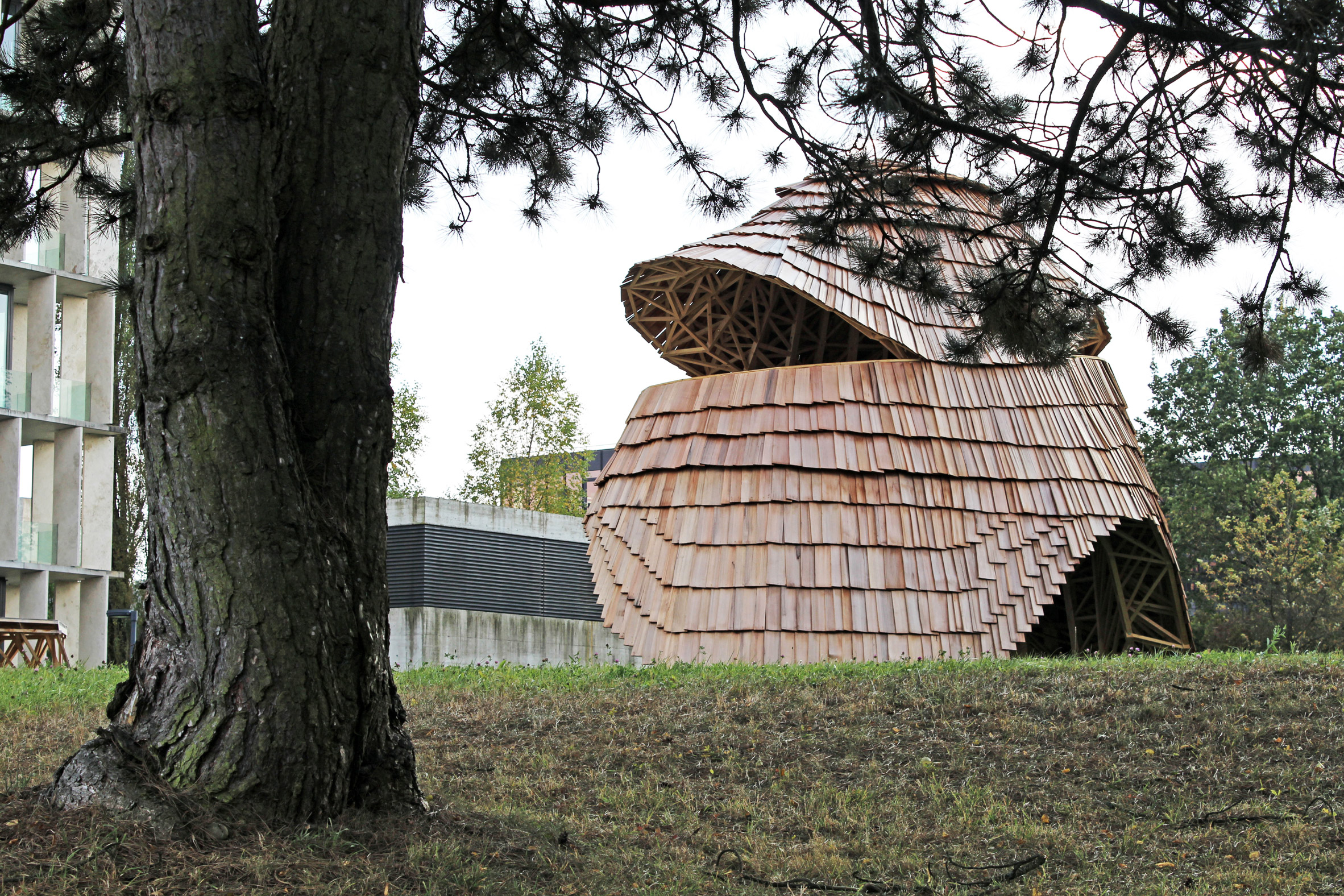 ETH Zurich students create robot-built pavilion with a skin of wooden shingles