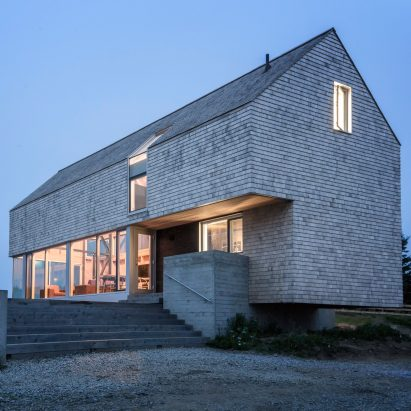 mackaylyons sweetapple elevates cedarclad cabin in nova scotia on concrete plinths