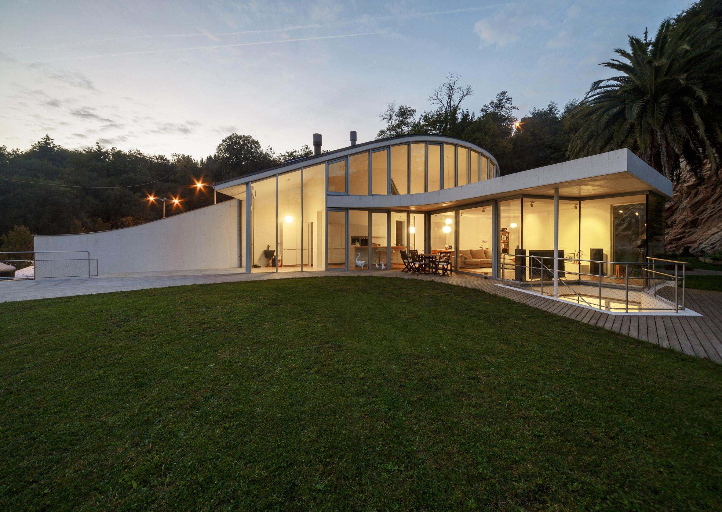 Zinc-covered bump creates double-height kitchen for San Sebastian home