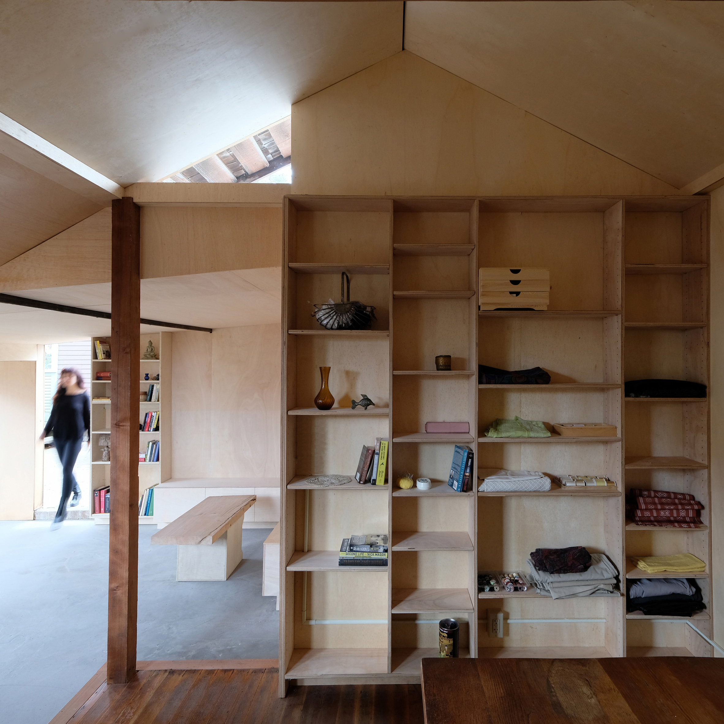 ArcHive turns Californian carriage house into plywood-lined sewing studio