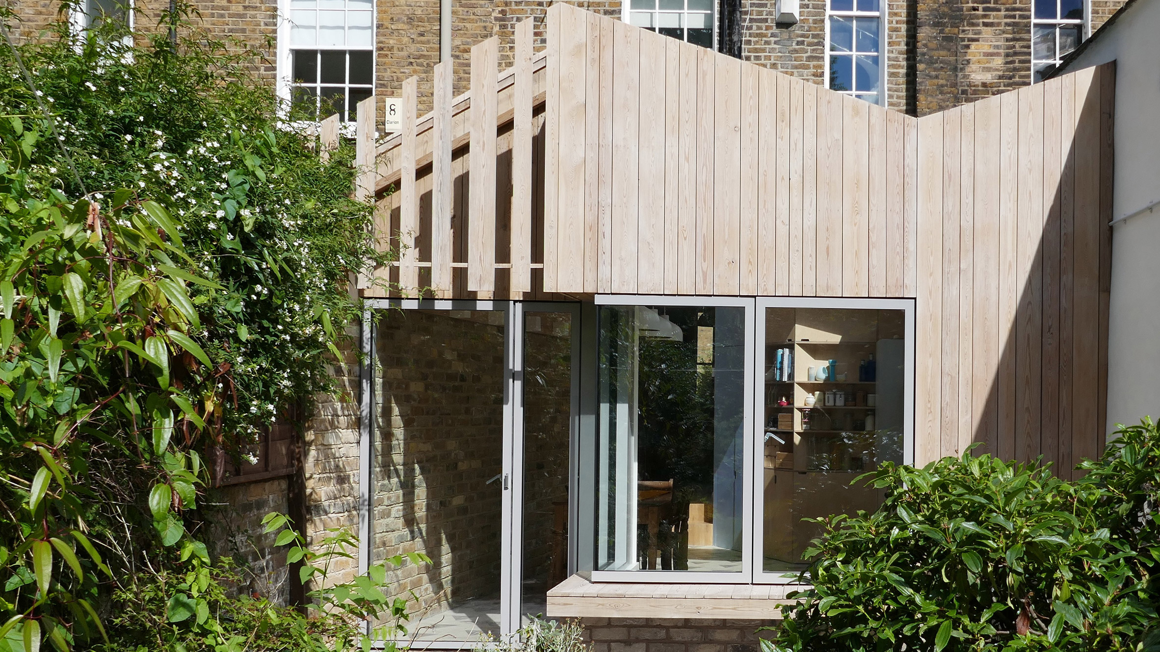 larch extension by pamphilon echoes london residence s butterfly roof