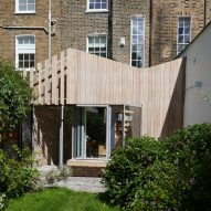 Pamphilon Architects' larch-clad extension echoes butterfly roof of east London terrace