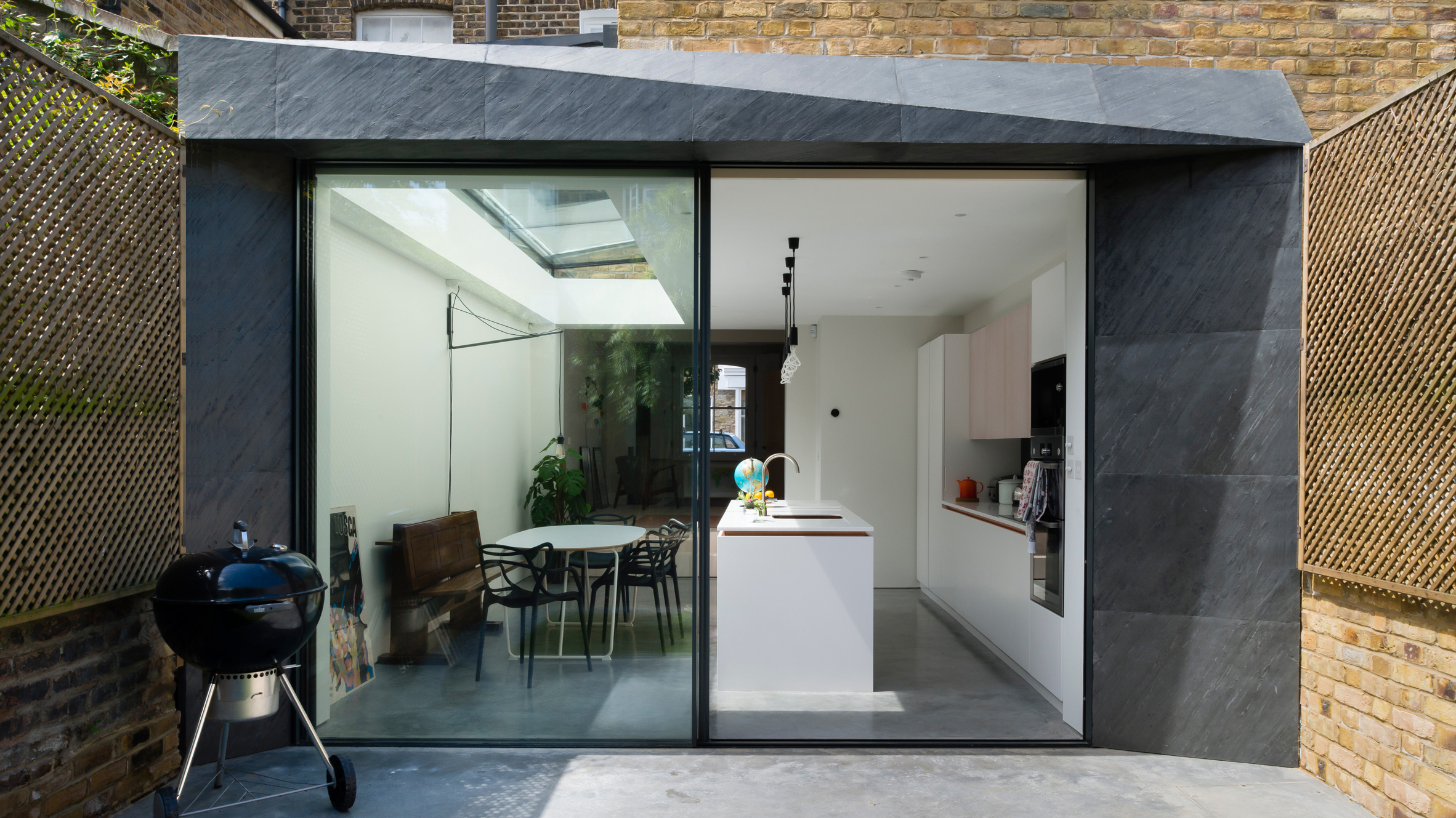 architecture for london builds one house extension in slate and another in brick - Slate House Design