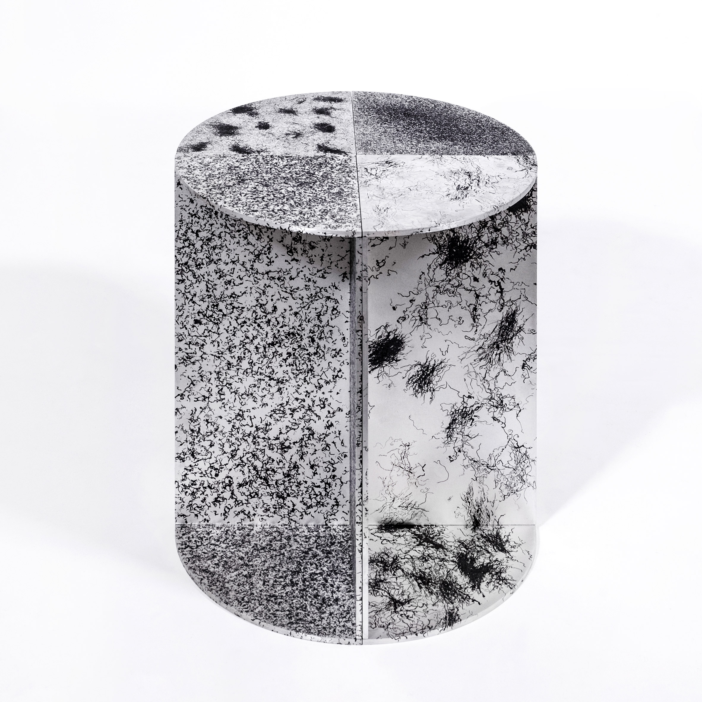 Burnt hair creates etch-like patterns on stools by Fabio Hendry and Martijn Rigters