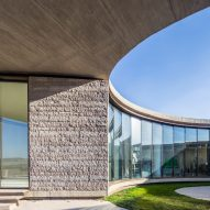 Elliptical cheese factory wraps glazed viewing courtyard
