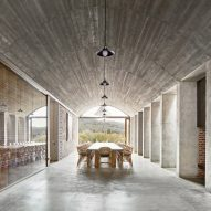 Tunnel links half-buried winery building in Girona with owner's house