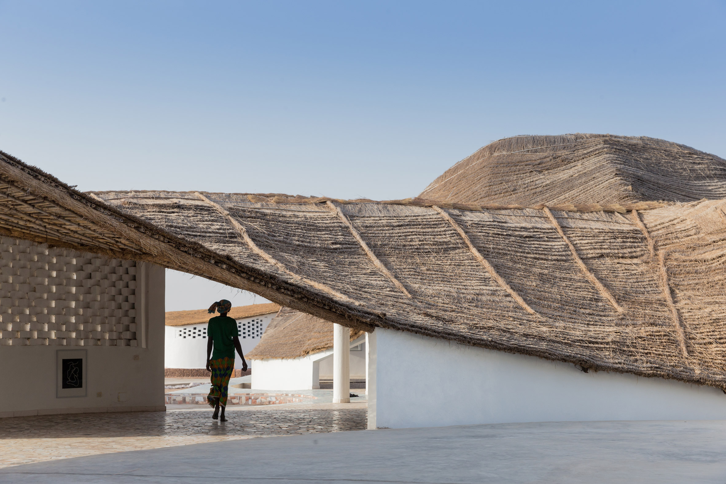 Toshiko Mori uses compressed earth and bamboo for cultural hub in remote Senegalese village