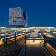 Undulating roof covers Benthem Crouwel's rail and bus station in Utrecht
