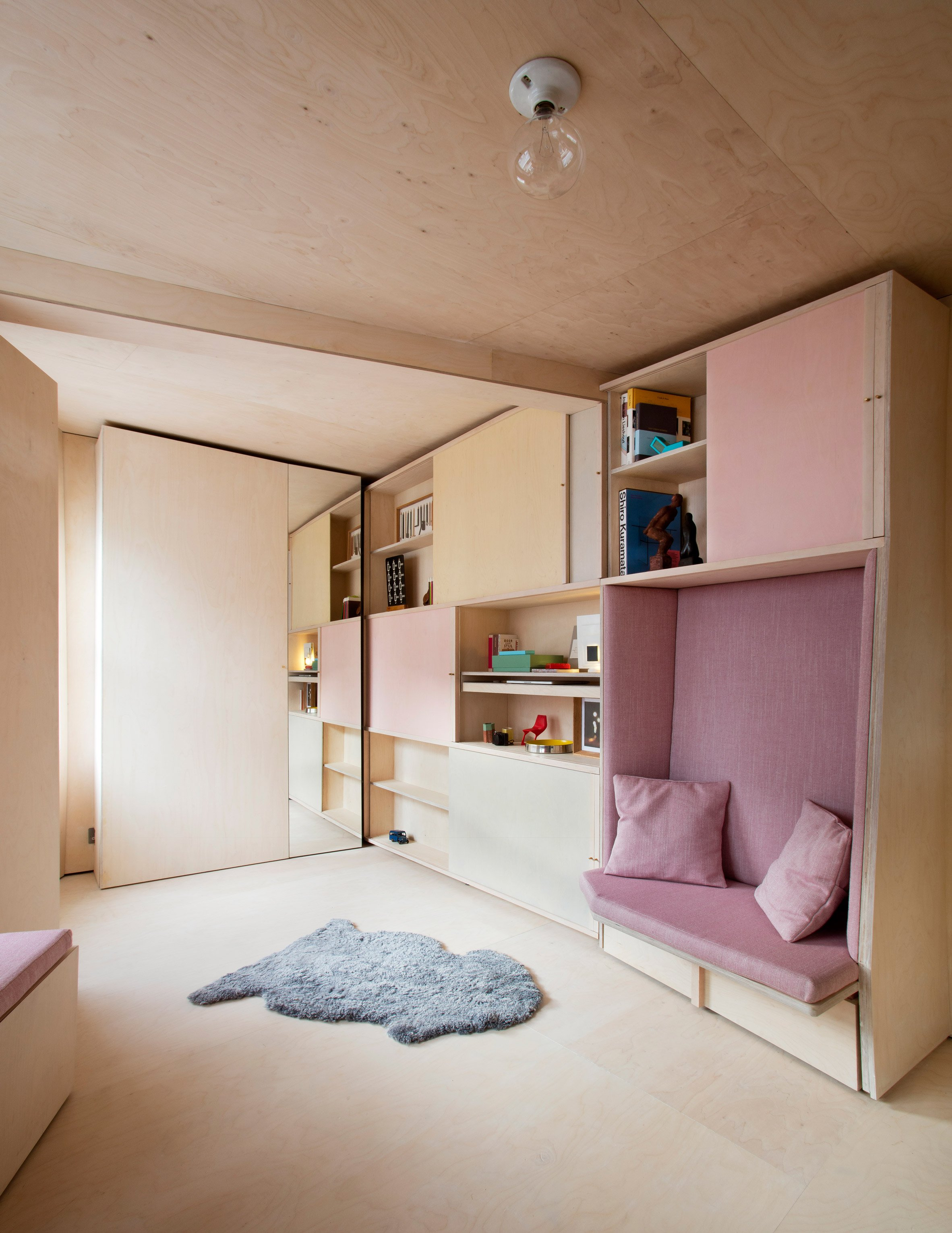 Studiomama uses sliding plywood furniture to overhaul 13-square-metre house in London