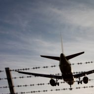Plane Flying Over Fence