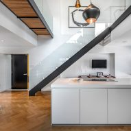 Peart/Weisgerber Residence at Habitat 67 by Moshe Safdie renovated by EMarchitecture Kitchen and Staircase Side View