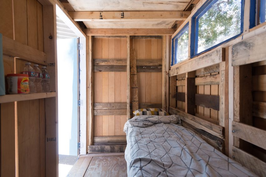 Tiny Home - interior with bed, shelves and windows
