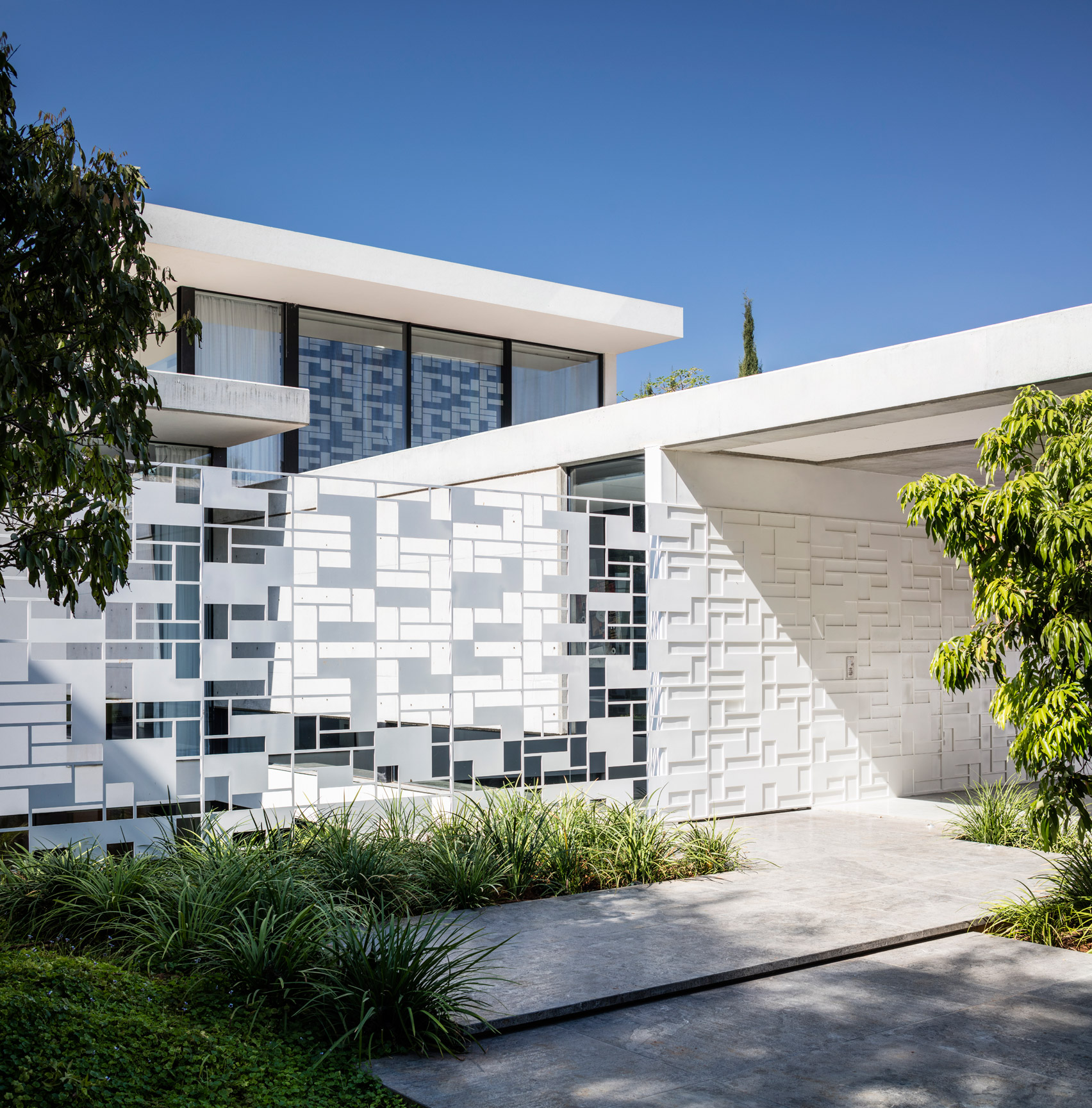 Pitsou Kedem's AB House features grid-like perforated screens inside and out