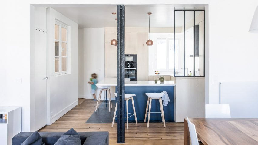 anne laure dubois uses dark blue tiles and poplar plywood to update paris apartment
