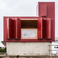 Red beach hut by Jonathan Hendry Architects stands atop former toilet block