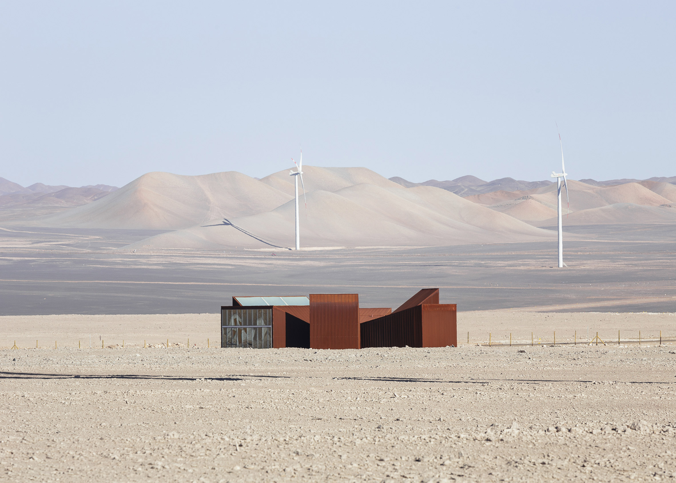 Rusty steel wedges surround desert garden in Chile's Atacama Desert