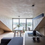 Smoked oak and rustic clay line walls of Japanese-styled apartment by Simon Astridge in London