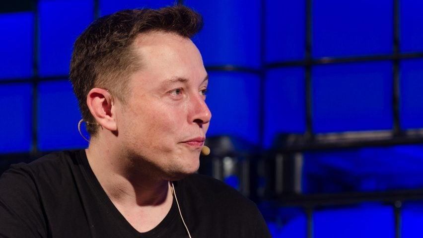 Elon Musk against blue background