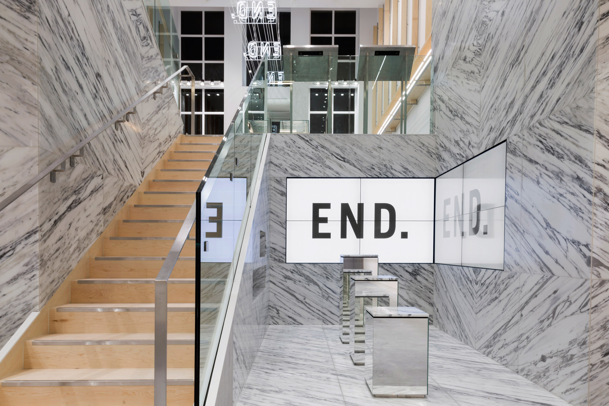 Brinkworth uses mirrors and marble for end clothing s new for Interior design agency glasgow