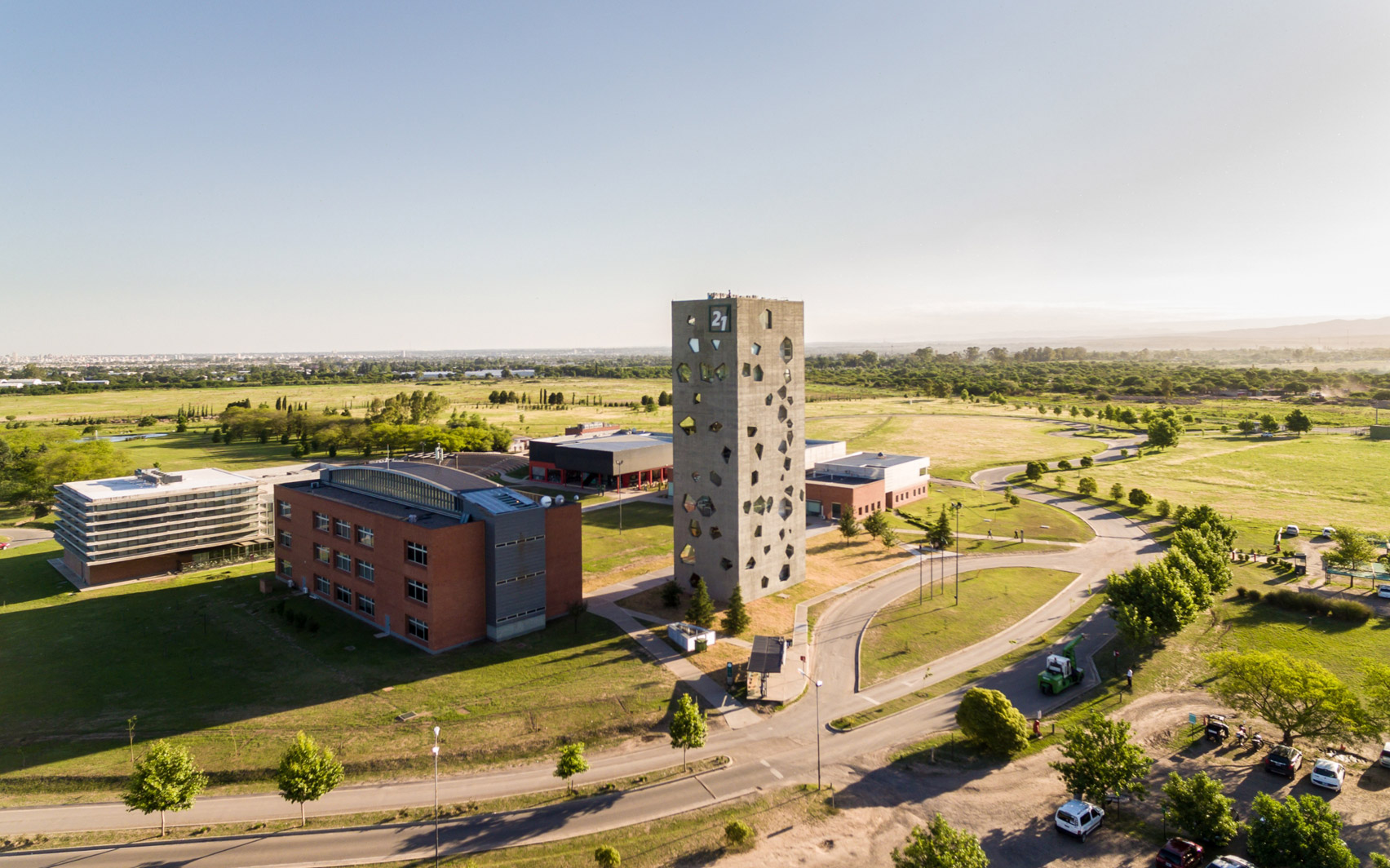 Angular openings puncture concrete facades of Lucio Morini's university tower