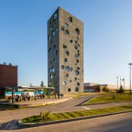 Angular openings puncture concrete facades of university tower by Morini Arquitectos