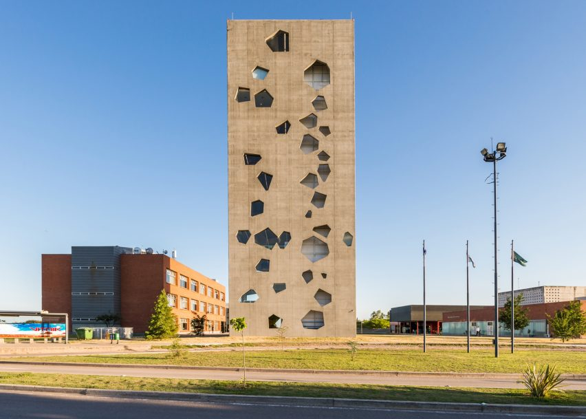 Angular openings puncture concrete facades of university tower by Morini  Arquitectos c1993a4294034