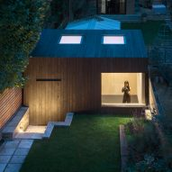 Eastwest Architecture adds charred-cedar gym to garden of London home